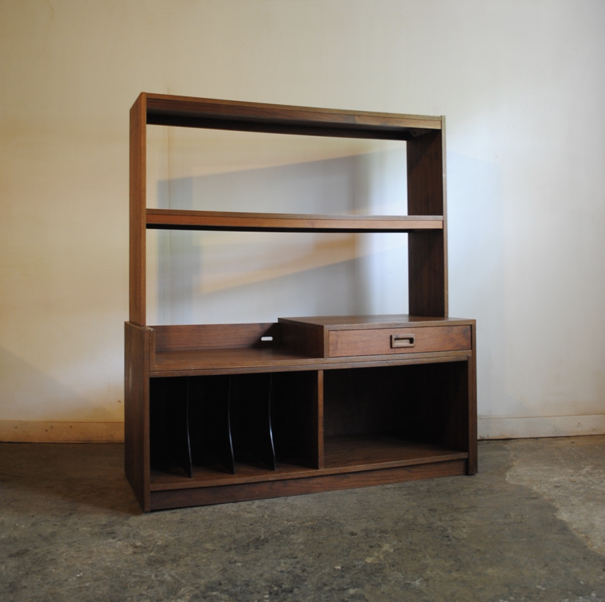 midcentury modern expandable record cabinet media console lower cabinet easily slides out to adjust width of the unit has spot for turntable and