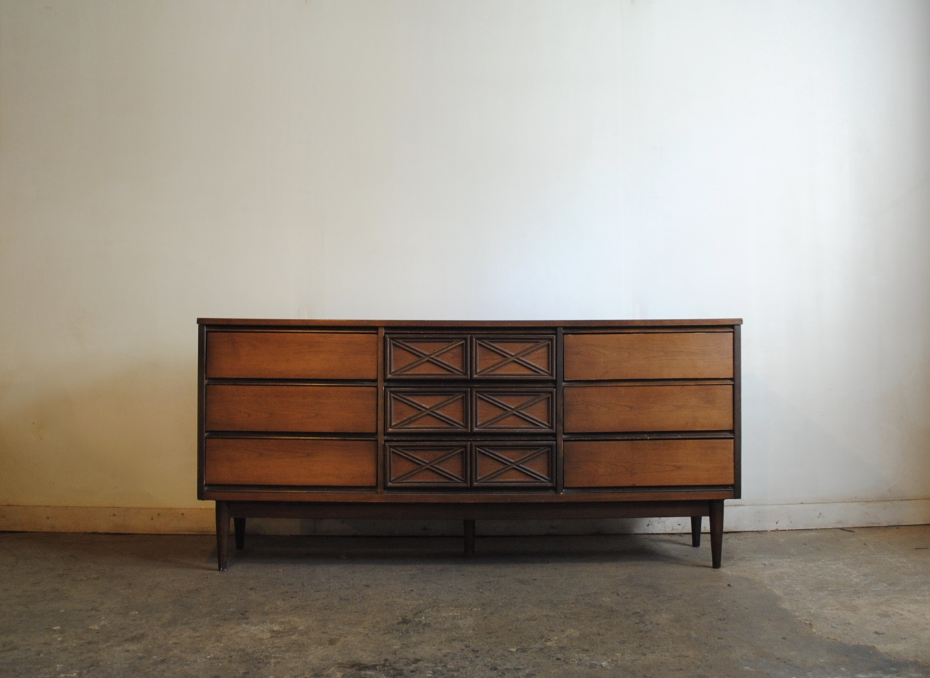 midcentury modern walnut nine drawer dresser has very durable laminate top dimensions are 64u2033w x 1775u2033d x 30u2033h please contact me with any questions
